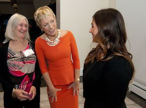 Barbara Corcoran, real estate mogul and private investor on Shark Tank , center, chat with Courtney Ligi, right, and her mother Nancy Ligi of Prospect, left, during the annual Waterbury Regional Chamber's 2014 Business Women's Forum held Friday at the Aqua Turf in Southington. The event also had Amanda Gore, international speaker and CEO of The Joy Project as well as featured workshops.  Jim Shannon Republican-American
