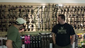Scott Murray,(right) a manager at Northwest Sporting Good in Winsted, helps Edward Bombard of Winsted look through the store's bow selection Tuesday.