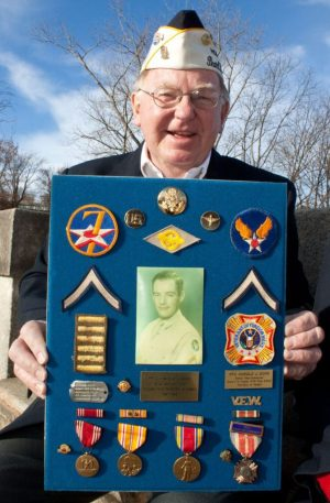 Bob Dorr proudly holds a plaque of his dad's military memorabilia in 2012. 7th U.S. Army Air Force PFC Harold J. Dorr was stationed at Pearl Harbor just a few weeks before the infamous attack. Republican-American archive