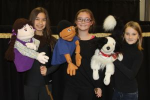 Kaitlin Torres, Jasmin Gaura and Miranda Carl demonstrate some of the Puppets of Praise used in programs presented Saturday afternoon during Christmas in Riverton. All are from Barkhamsted.