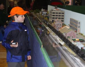 Andrew Turgeon examines the model railroad layout displayed by the Torrington Area Model Railroaders Saturday afternoon during Christmas in Riverton.