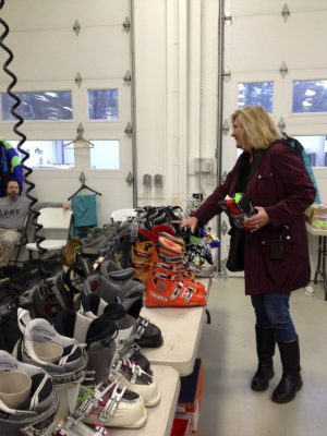 Dana Scarpa of Salisbury looks over the line of ski boots available at Salisbury Winter Sports Association's ski and swap sale Saturday held at the Lakeville Hose Company firehouse. Between $4,000 and $5,000 is usually raised to provide for lessons and equipment for children throughout the area enrolled in the ski program who otherwise could not participate. Ruth Epstein Republican-American