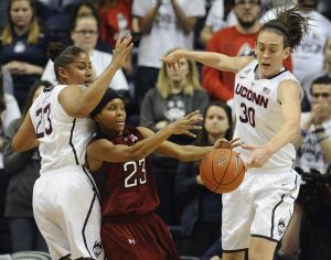 Connecticutís Kaleena Mosqueda-Lewis, left, and Breanna Stewart, right, pressure Templeís Tyonna Williams, center, during the second half of an NCAA college basketball game, Wednesday, Jan. 14, 2015, in Storrs, Conn. Connecticut won 92-58. (AP Photo/Jessica Hill)