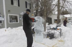 John Hedbavny creates an ice sculpture of an Eskimo during an ice carving demonstration Saturday as part of Salisbury Winter Sports Association's Jumpfest weekend. Ruth Epstein Republican-American