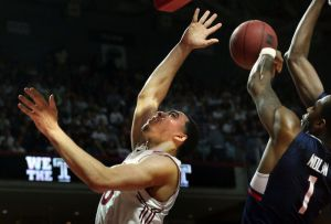 Temple forward Obi Enechionyia (0) is fouled by Connecticut forward Phillip Nolan (1) in the second half of an NCAA college basketball game, Saturday, March 7, 2015, in Philadelphia. Temple won 75-63. (AP Photo/Laurence Kesterson)
