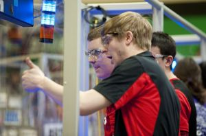 Cheshire High School's Team MechaRams Eric Scheuing, left, gives instructions to teammate Nick Druckrey, left, as they compete in the FIRST Robotics Competition, Waterbury District Event, in February at Wilby High School in Waterbury.  Republican-American Archive
