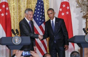 President Barack Obama shakes hands with Singapore's Prime Minister Lee Hsien Loong at the conclusion of a joint news conference at the White House in Washington, Tuesday, Aug. 2, 2016. The prime minister of the Southeast Asian city state joins Obama in Washington to celebrate the 50th anniversary of diplomatic relations and the contentious Trans-Pacific Partnership free trade deal is high on their agenda. (AP Photo/J. Scott Applewhite)