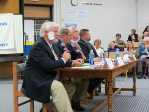 Craig Miner, left, Republican candidate for the 30th Senate District, answers a question during Friday night's debate at Housatonic Valley Regional High School in Falls Village. Others on the panel, from left, are Miner's Democratic opponent, David Lawson, Democratic candidate for the 64th District House, William O. Riiska, and his Republican opponent, Brian M. Ohler. Ruth Epstein Republican-American