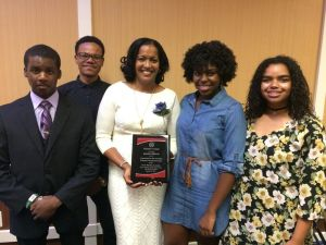 Waterbury teacher Jahana Hayes, national teacher of the year recipient, poses with students Deandre Carty, Devon Jones, Ashley Lamb and Evelyn Lopez after receiving the President's Award at the NAACP Greater Waterbury Branch's 74th Freedom Fund Awards Luncheon on Saturday at the Courtyard Marriott in Waterbury.