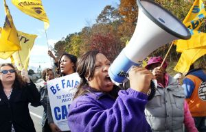 Merinda Williams an organizer for 1199 from New Haven leads a picket line in front of Rosegarden Health & Rehab Center on East Main Street in Waterbury Tuesday.  Steven Valenti Republican-American