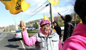 Evelyn Williams of Waterbury participates in a picket line in front of Rosegarden Health & Rehab Center on East Main Street in Waterbury Tuesday.  Steven Valenti Republican-American