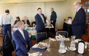 From left, Ryan Rogers, Democratic candidate for 16th District Senate, Rob Sampson, R-Wolcott, and Sen. Joseph C. Markley, R-16th District get ready to speak during the Wolcott Chamber of Commerce candidates forum in Wolcott on Wednesday. Steven Valenti Republican-American