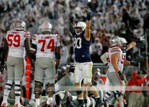 Penn State's Garrett Sickels (90) celebrates after a fourth down sack of Ohio State quarterback J.T. Barrett (16) during the second half of an NCAA college football game in State College, Pa., Saturday, Oct. 22, 2016. Penn State won the game 24-21. (AP Photo/Chris Knight)