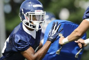 Connecticut cornerback Byron Jones runs a drill during NCAA college football practice in Storrs, Conn., Friday, Aug. 2, 2013. (AP Photo/Jessica Hill)