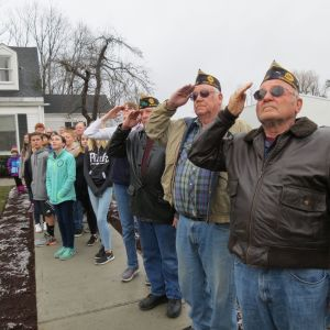 Veterans, from left, Miriam Jones, Robert Hock, Ray Aakjar and Ed Wilbur salute as the flag is raised Wednesday.