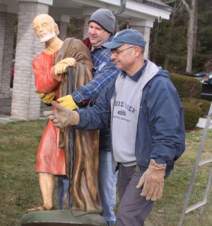 Photos by John McKenna Republican-American Don Nardozzi, right, grand knight of the Knights of Columbus at St. Thomas of Villanova Church in Goshen, and Charlie Williams set up the life-size Nativity scene at the church.
