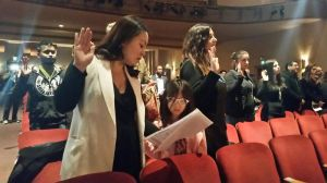 Anh Noc Phan, 41, of Meriden, was among 35 new citizens taking the Oath of Allegiance during a ceremony Wednesday at the Klein Memorial Auditorium. She was joined by her 7-year-old daughter.