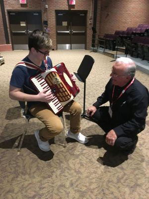 Accordion player and certified teacher Peter Peluso works with a Wolcott High School student. The school is part of the Connecticut Accordion Association's pilot program aimed at reintroducing the instrument to young people. Contributed