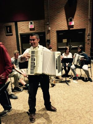 Wolcott High School band teacher Justin Clement plays the accordion in front of his students. The school is part of the Connecticut Accordion Association's pilot program aimed at reintroducing the instrument to young people. Contributed