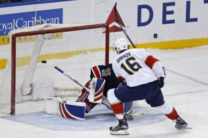 Florida Panthers center Aleksander Barkov (16) scores the game-winning goal past New York Rangers goalie Antti Raanta (32) in the shootout of an NHL hockey game, Friday, March 17, 2017, in New York. The Panthers defeated the Rangers 4-3. (AP Photo/Adam Hunger)