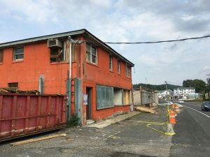 This orange building, once part of the Waterville Lumber Yard, will be renovated into a Christian bookstore/coffeehouse under an ambitious plan by First Assembly of God Church on Thomaston Avenue in Waterbury to create a complex that will also include a food pantry and day care center.