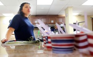 Daisy Garcia of Waterbury volunteers to work in the kitchen serving food at a first responder appreciation event at First Assembly of God in Waterbury on Monday.  Steven Valenti Republican-American