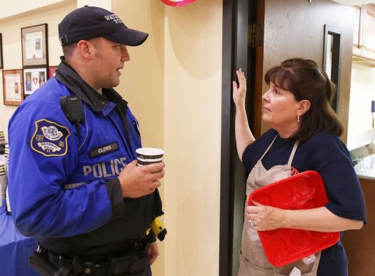 Waterbury Police Officer Chris Clews thanks Wendy Vestro of Waterbury for running the first responder appreciation event at First Assembly of God in Waterbury on Monday.  Steven Valenti Republican-American
