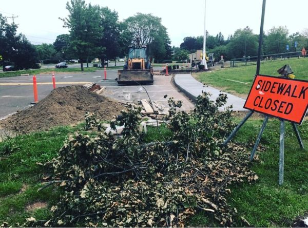 Sidewalk repairs at Cheshire High School over the summer. Other town and school infrastructure improvements are among the projects Cheshire voters will decide as referendum questions Tuesday. Republican-American archives