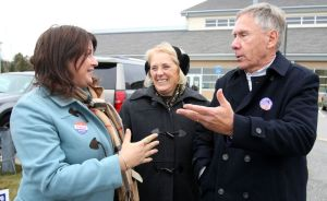 From left, Michelle Lucan talks with Plymouth Mayor David V. Merchant and his wife, Jackie, outside the Terryville High School polling site on Tuesday. Merchant is seeking his third term. Steven Valenti Republican-American
