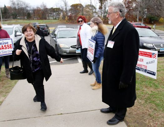 Lillian Grant of Wolcott is greeted by Roger P. Picard, Republican candidate for Town Council at the High School in Wolcott Tuesday. Steven Valenti Republican-American