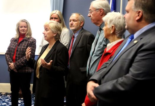 A. Candy Perez, second from left, speaks after being voted in as Winsted mayor again following the swearing-in of the Board of Selectmen on Wednesday at Town Hall. Steven Valenti Republican-American