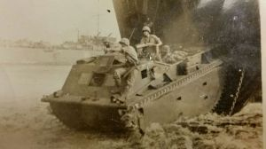 Theodore R. Marolda of Winsted was part of the Marines' first amphibian tank battalion during World War II. The tanks transported troops, weapons and ammunition, and supplies from ship to shore. Here, Marolda mans a machine gun while troops unload at the Battle of Cape Gloucester in the Pacific theater. The two Marines at the front of the tank went into the jungle and never returned. They remain missing in action to this day. 'We don't know what the heck happened to them,' Marolda said. Contributed