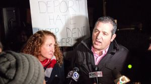 Viron Rondos, right, speaks to reporters with Rep. Elizabeth H Esty, D-5th District, at a protest at Cheshire's First Congregational Church on Sunday to stop the deportation of Rondos' wife, Denada Rondos, to Albania. Denada Rondos came to the United States on a false passport in 2002, when she was 16. Devin Leith-Yessian Republican-American