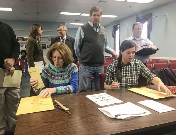 Christine Wellins, left, and Kathryn Bennett count ballots in a recount of Cheshire's Council District 1 election Monday at Town Hall. Ajhani Ayres Republican-American