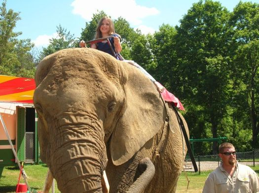 Juliana Palmer-Paton, 11, of Sharon, rides Karen the elephant owned by R.W. Commerford & Sons in Goshen, during an event in Canaan in 2010. Ruth Epstein Republican-American