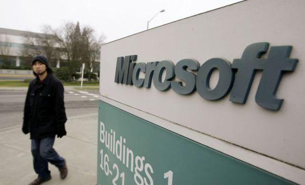 In this Jan. 22, 2009, file photo, a man walks on the Microsoft headquarters campus in Redmond, Wash. Microsoft says it's overhauling its longtime headquarters with an 18-building construction project that will make room for another 8,000 workers. The announcement came ahead of the company's annual shareholders meeting Wednesday, Nov. 29, 2017. (AP Photo/Elaine Thompson, File)