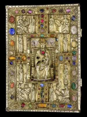 Jeweled cover of the Berthold Sacramentary, with statuette of the Virgin and Child in the center, the four evangelists in the corners, and eight other figures, including abbot Berthold himself. On: The Berthold Sacramentary, in Latin, Weingarten Abbey, Germany, ca. 1215-1217, for Berthold, abbot from 1200 to 1232. Manuscript on vellum. Purchased by J.P. Morgan, 1926.