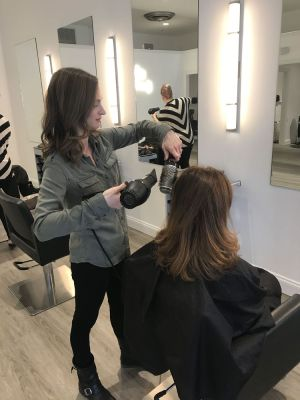 Contributed Ashley Ayers, owner of Salon 27 in New Milford, gives Dee Gresco of Washington a new look. Her 'blowout' service is in hot demand.