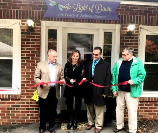 Dawn Romaniello's healing center, In Light of Dawn, celebrated its opening at 271 Litchfield Road in Harwinton on Oct. 26. The business opened in the former E & E tool & Die building. She offers life coaching, reiki energy, pet reiki, reflexology, cranial sacral therapy and facials. In the photo are Sen. Henri Martin, R-Bristol, Romaniello, First Selectman Michael R. Criss and Tom Schoenemann, chairman of the economic development commission. Contributed photo.