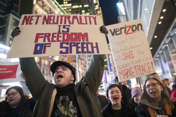 Demonstrators rally in support of net neutrality outside a Verizon store, Thursday, Dec. 7, 2017, in New York. The FCC is set to vote Dec. 14 whether to scrap Obama-era rules around open internet access that prevent phone and cable companies from favoring certain websites and apps. (AP Photo/Mary Altaffer)