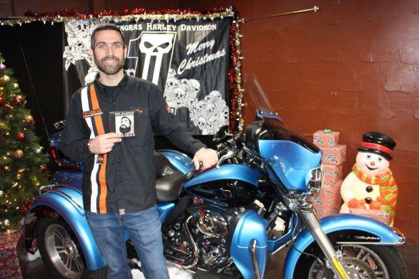 Bud Wilkinson Republican-American Gengras Harley-Davidson general manager Joe Barone displays the new CD, 'Some Grace,' by Joe Barone & The Remedies.