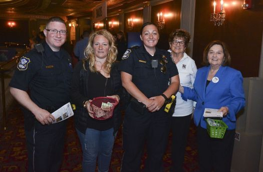 Waterbury police officer Chris Gagnon; Campership Director Sandy Monteiro; Waterbury police officer Chris Gagnon, a volunteer from the Palace Theatre and Campership Director Joyce DeCesare pose for a photo as the officer and Camership Directors and other volunteers, collect donation for the Greater Waterbury Campership Fund during intermission at the Palace Theatre in Waterbury. Jim Shannon Republican-American