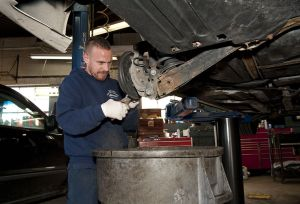 WATERBURY, CT-051117JS01- Todd LaPorta, a mechanic at United Auto in Waterbury, work on rear brakes on Thursday during the AC Delco's Day of Caring. United Auto will service a few dozen cars owned by low income people for free. The garage has been participating in the program for two years. This is the 15th year AC Delco has held the event nationwide.   Jim Shannon Republican-American