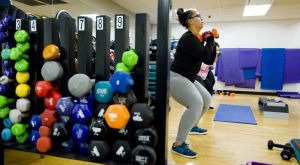 Leah Mayo of Waterbury, works on sumo squats during Kalen Greene's Shred class Wednesday at the Waterbury YMCA. Shred is a cardio class that focuses on body weight exercises for strength and cardio conditioning.  Jim Shannon Republican-American