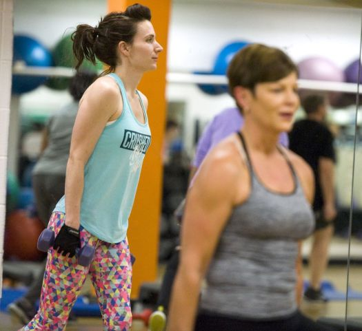 Michelle Stankus of Watertown, left, and Tricia Maia of Southington, work on cool-down exercises in Kalen Greene's Shred class Wednesday at the Waterbury YMCA. Shred is a cardio class that focuses on body weight exercises for strength and cardio conditioning.  Jim Shannon Republican-American