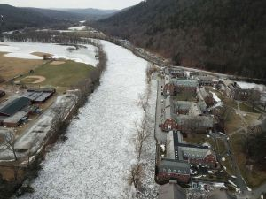 A view from a drone shows the buildup of the ice on the Housatonic River next to Kent School, on the right. The independent school decided to cancel classes for the week and send students home on Monday. Kent Center school is located on the left side of the river. Photo courtesy of Bernie Meehan