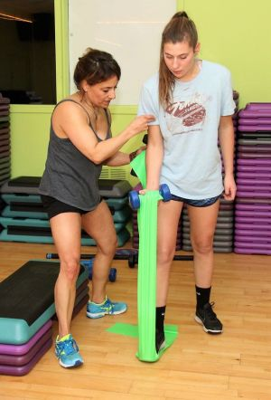 Marci Vincitorio, left, a trainer at the Litchfield Athletic Club, works with Eleni Kolpak, a student at The Gunnery in Washington, Conn., during the class Vincitorio runs for high school students. John McKenna Republican-American