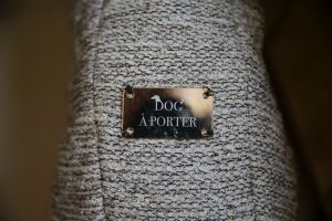 This image taken on Thursday, Jan. 11, 2018, shows a label on a dog coat created by designer Giovanna Temellini, at the Temellini manufacture headquarters, in Milan, Italy. Milan has long been known for its pret-a-porter. Now the pooches want in with a new line of haute couture for canines: Temellini Dog a Porter. (AP Photo/Luca Bruno)