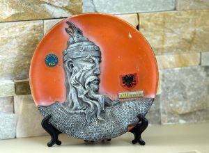 A plate depicting Skanderbeg is on display at the Naugatuck home of Tasim Tasimi. Local Albanians prepare to celebrate the