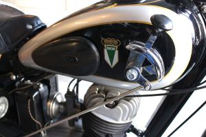 Bud Wilkinson Republican-American The logo with interlinked four rings thats associated these days with the Audi car brand can be seen in the decal on the right side of the gas tank. Also visible is the hand shifter.